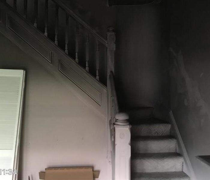 White Staircase Restored Following Fire Before