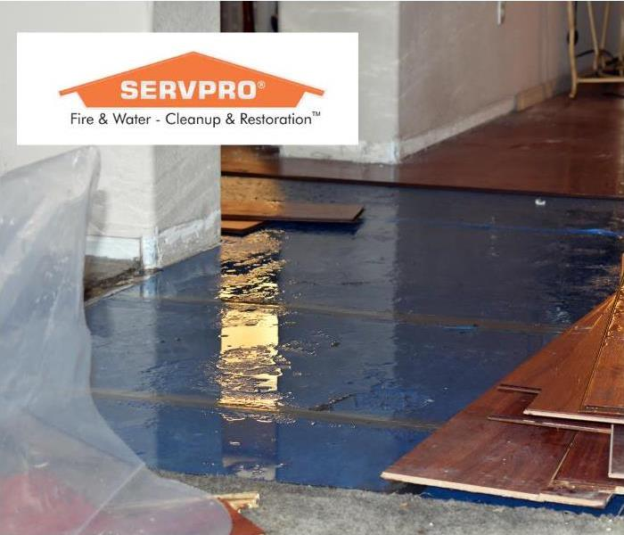 Home with flooded and damaged floor.